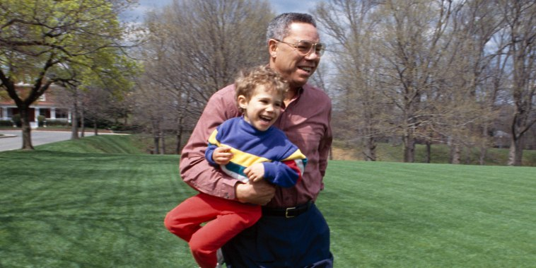Colin Powell Plays With His Grandson