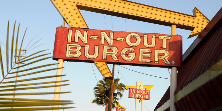 In-N-Out Burger signs fill the skyline on Tuesday, June 8, 2010, in Calif. The In-N-Out hamburger chain is sizzling mad after San Francisco shut down its indoor dining for refusing to check customers' vaccination status. The company's Fisherman's Wharf location -- its only one in San Francisco -- was temporarily shut by the Department of Public Health on Oct. 14.