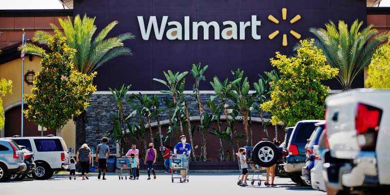 Shoppers in the parking of a Walmart Superstore in Rosemead, Calif.