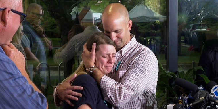 A tearful Nichole Schmidt, the mother of Gabrielle Petito, is comforted by her husband Jim Schmidt during a news conference on Sept. 28, 2021, in Bohemia, N.Y.