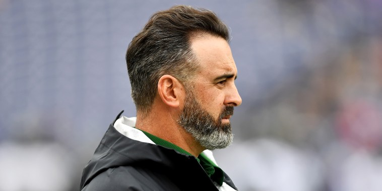 Head coach Nick Rolovich of the Hawaii Warriors watches his team warm-up before the game against the Washington Huskies on Sept. 14, 2019, in Seattle.