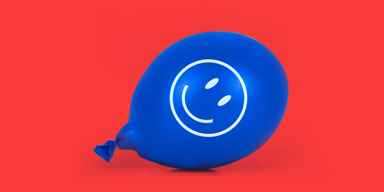 Photo illustration: A blue balloon with a smiley face lying on the floor.