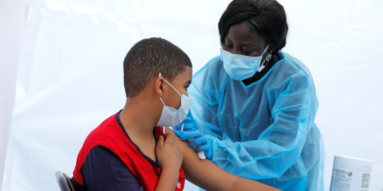 A 12-year-old receives a Covid-19 vaccine in the Bronx, New York, on June 4, 2021.