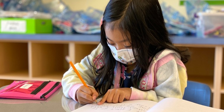 Image: Armele Correa, 7, writes in her school journal about what she plans to do at home over the summer of 2021.
