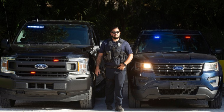 Officers with the North Port Police Department secure the entrance to Myakkahatchee Creek Environmental Park on Oct. 20, 2021 in North Port, Fla.