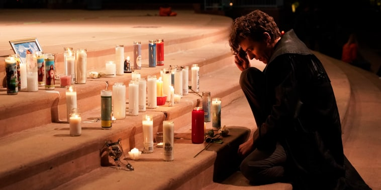 Film industry worker Jake Extine pays his respects for cinematographer Halyna Hutchins during a candlelight vigil in Albuquerque, N.M., on Oct. 23, 2021.