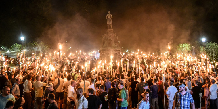 """White nationalists march on the grounds of the University of Virginia ahead of the \""""Unite the Right Rally\"""" in Charlottesville on Aug. 11, 2017."""