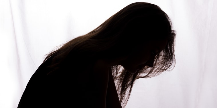 Silhouette of a young woman with problems