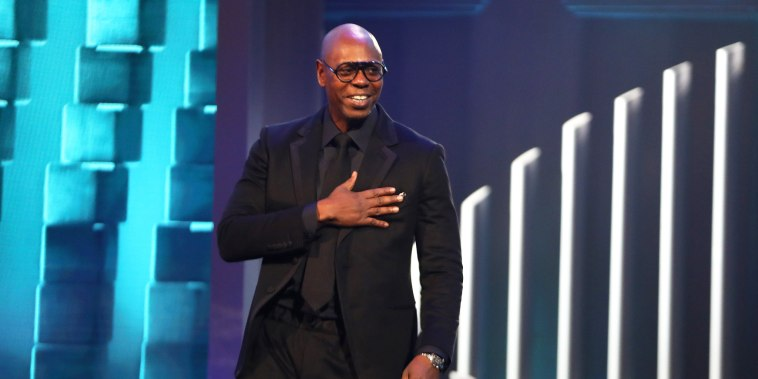 Dave Chappelle accepts the Mark Twain Prize for American Humor at the Kennedy Center in Washington on Oct. 27, 2019.