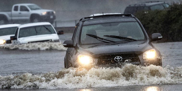 Image: Vehicles drive through a flooded area in Fairfield, Calif., on Oct. 24, 2021.