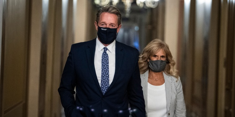 Former Sen. Jeff Flake, R-Ariz., nominee to be ambassador to Turkey, and his wife Cheryl, are seen in the U.S. Capitol on Oct. 19, 2021.