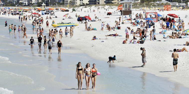 Image: Visitors at Clearwater Beach, Fla.,