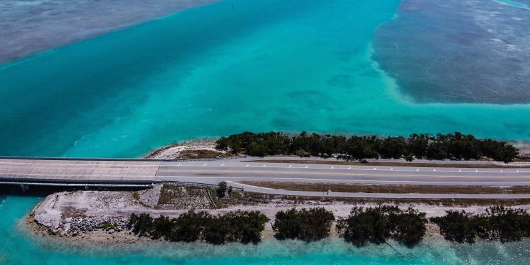 An aerial view shows deserted country road 905 in Key Largo, Fla., March 22, 2020. A criminal complaint said Garcia and Fonseca asked someone who really was an undercover agent if they could borrow a boat earlier this month to smuggle people from Cuba into the U.S. Garcia told the agent the boat would be stored at a Key Largo home, which operated as a staging area and a place to hold migrants until their smuggling fees were paid, officials said.
