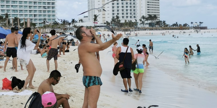Tourists enjoy a public beach in Cancun, Mexico March 9, 2021.