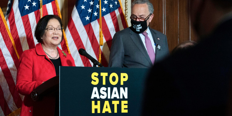 Sen. Mazie Hirono, D-Hawaii, accompanied by Senate Majority Leader Chuck Schumer speaks on Capitol Hill on April 13, 2021.
