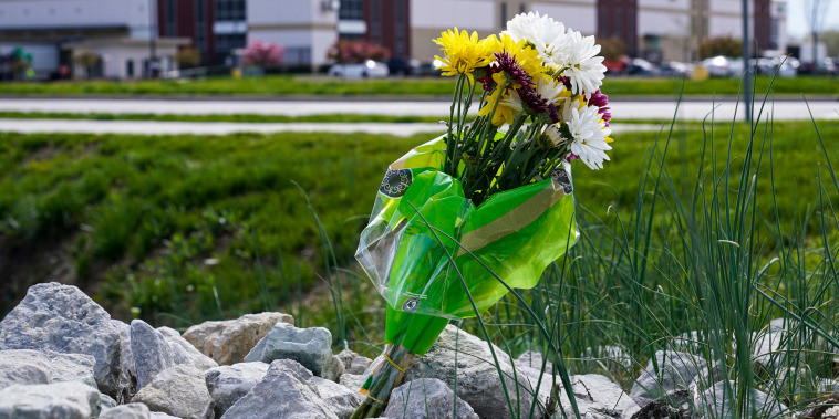 A single bouquet of flower sits across the street from the FedEx facility in Indianapolis on April 17, 2021, where eight people were shot and killed.