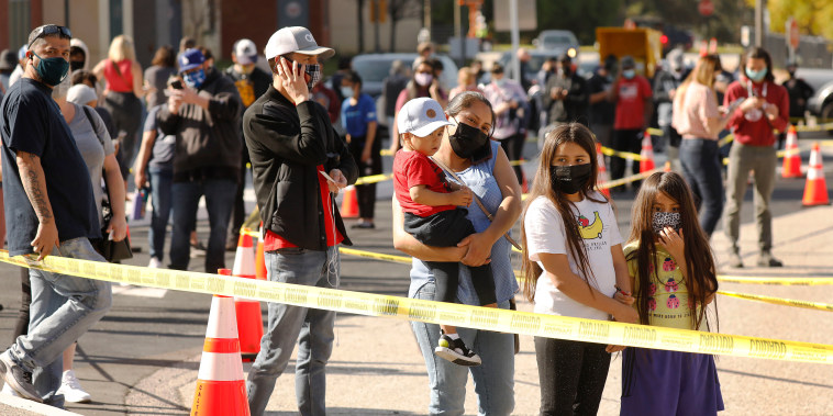 Guadalupe Oidor and her children from Boyle Heights wait for their vaccine in Los Angeles on April 8, 2021.