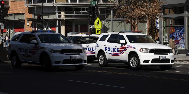 Metropolitan Police Department vehicles block traffic in Washington on March 14, 2021.