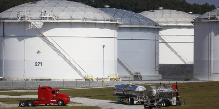 Tanker trucks are parked at the Colonial Pipeline Co. Pelham junction and tank farm in Pelham, Ala., on Sept. 19, 2016.