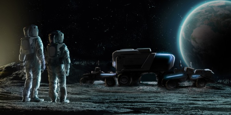 Future Artemis astronauts gaze at concepts of of lunar mobility vehicles, or rovers, developed by Lockheed Martin and GM.