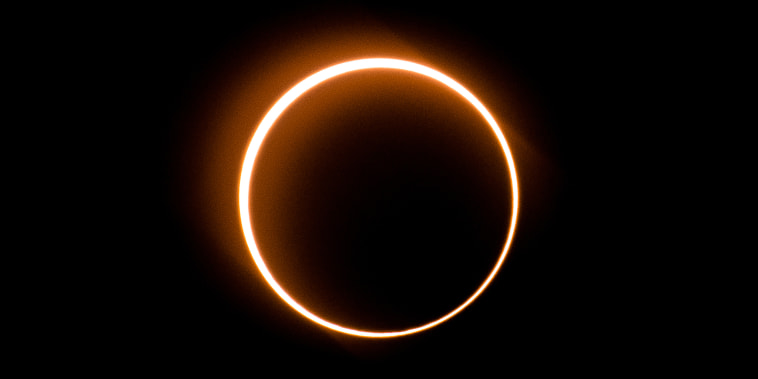 """Image: The moon moves in front of the sun in a rare """"ring of fire"""" solar eclipse as seen from Tanjung Piai, Malaysia on Dec. 26, 2019."""