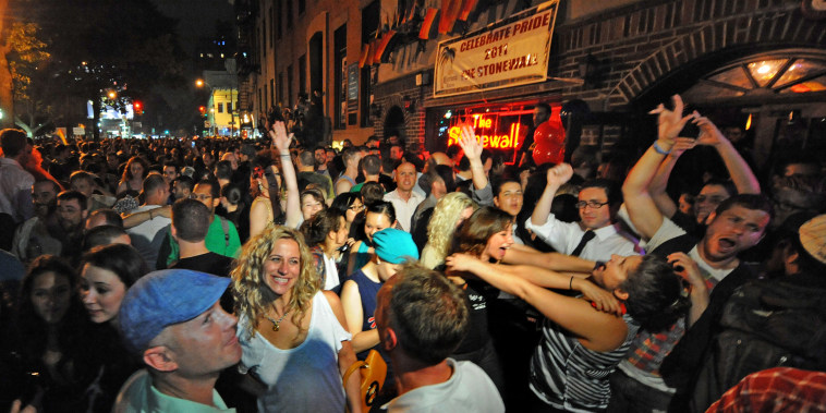 People celebrate in front of the Stonewall Inn after the passing of the state's same sex marriage bill in New York, on June 24, 2011.