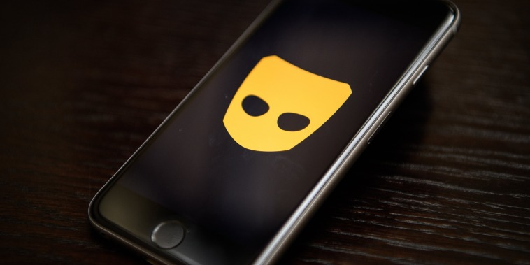 """The """"Grindr"""" app logo on a mobile phone screen."""