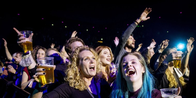 Visitors to the Ziggo Dome attend a performance by Dutch singer Andre Hazes in Amsterdam on March 7 2021 during a series of trial events in which Fieldlab is investigating how large events can take place safely.