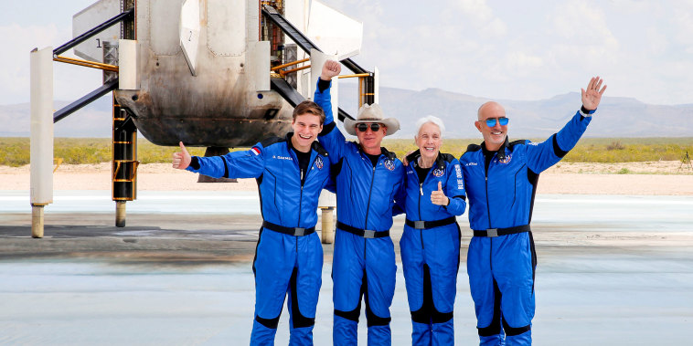 Jeff Bezos, second from left, with crew mates, from left, Oliver Damen, 18, Wally Funk, 82, and Mark Bezos at the landing pad after they flew on Blue Origin's inaugural flight to the edge of space, in the nearby town of Van Horn, Texas, on July 20, 2021.