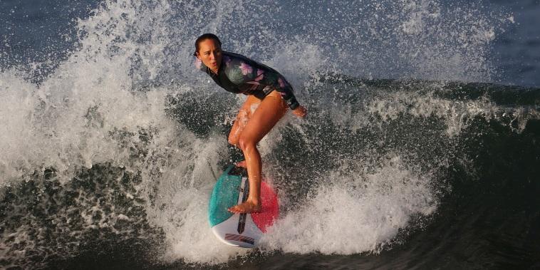Image: Carissa Moore trains for the Olympics at Tsurigasaki Surfing Beach, Tokyo, on July 23, 2021.