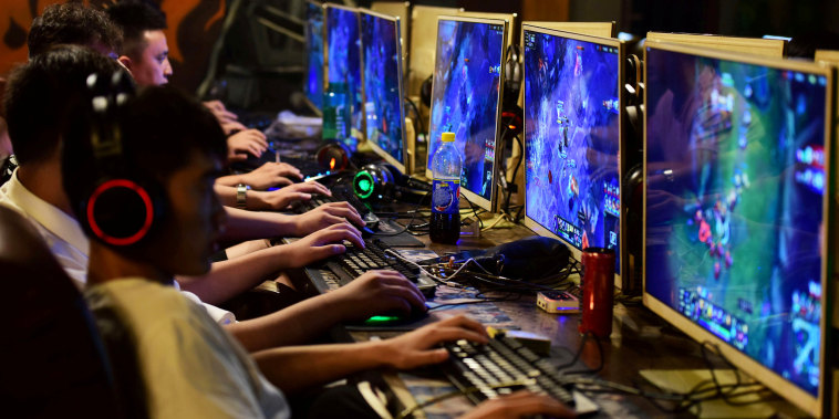 People play online games at an internet cafe in Fuyang, Anhui province, China on Aug. 20, 2018.