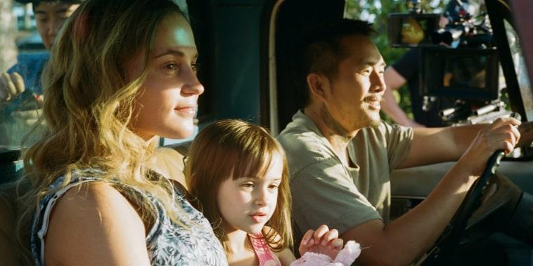 "Alicia Vikander, Sydney Kowalske and Justin Chon on the set of ""Blue Bayou."""