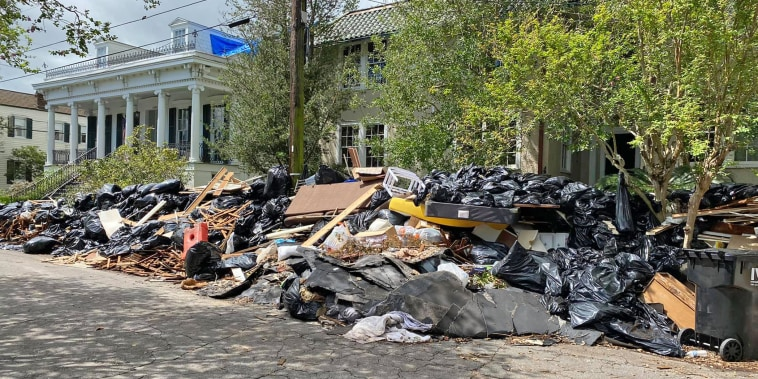 Image: Trash piled up on Bordeaux between St Charles and Pitt in New Orleans on Sept.16, 2021.