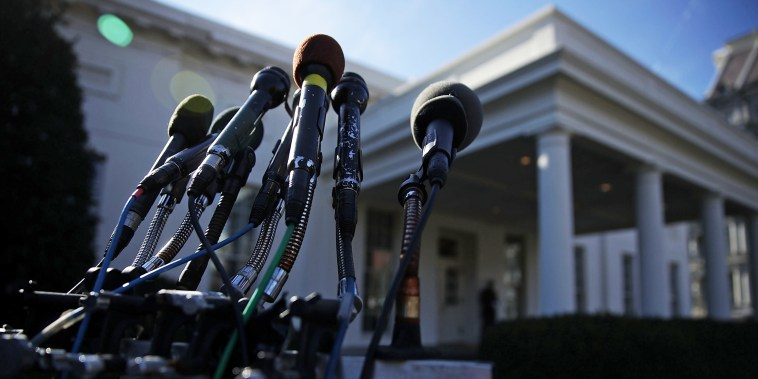 Microphones belong to different media outlets are set up on a stand in front of the West Wing of the White House on Jan. 31, 2017.