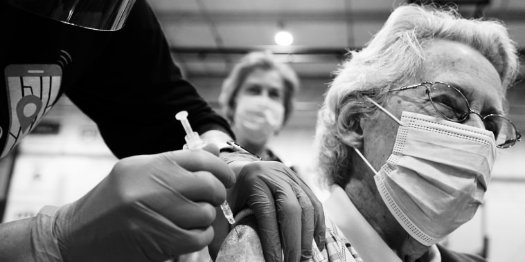 Image: A woman receives a Covid-19 vaccine in Martinsburg, W.V., on March 11, 2021.
