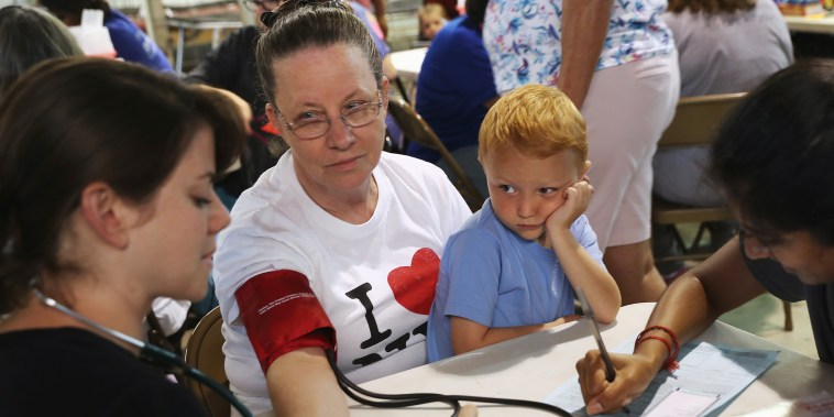 Image: Ruby Partin, 63, and her adoptive son Timothy Huff, 5, visit the free annual Remote Area Medical health clinic on July 22, 2017 in Wise, Va.