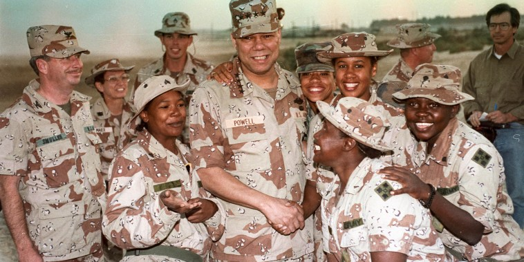 Chairman of the Joint Chiefs of Staff General Colin Powell and members of the 132nd MP Company in Saudi Arabia on Dec. 22, 1990.