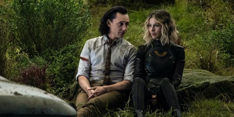 "Tom Hiddleston as Loki and Sophia Di Martino as Sylvie in Marvel Studios' ""Loki."""