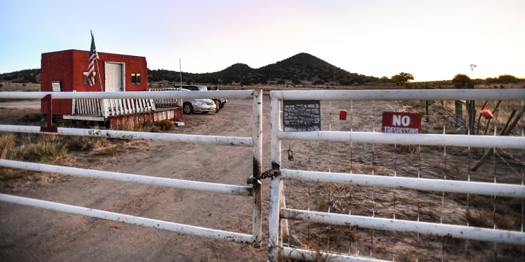 """A locked gate at the entrance to the Bonanza Creek Ranch where filming of the movie """"Rust"""" took place, on Oct. 22, 2021 in Santa Fe, N.M."""
