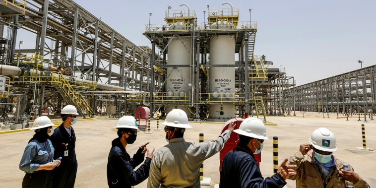 Saudi Aramco engineers and journalists look at the Hawiyah Natural Gas Liquids Recovery Plant in Hawiyah, in the Eastern Province of Saudi Arabia, on June 28, 2021