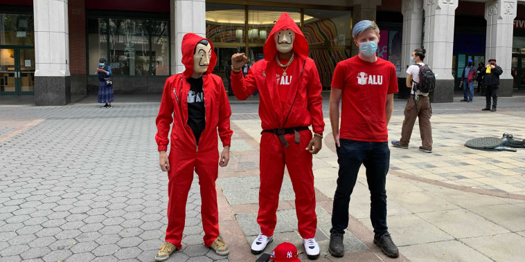 Amazon workers wear Squid Game costumes as filed a petition with the National Labor Relations Board's regional office in Brooklyn on Oct. 25, 2021.