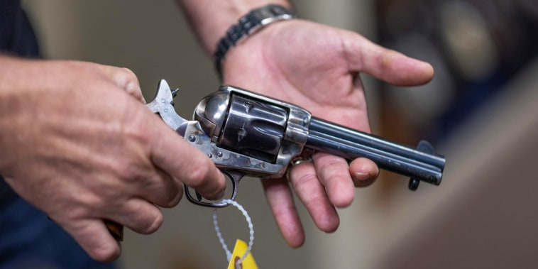 Props expert Guillaume Delouche at Independent Studio Services holds a prop gun in Los Angeles on Oct. 22, 2021.