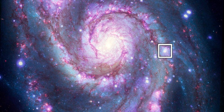 A box indicates the location of a possible exoplanet detected outside the Milky Way in a composite image from the Hubble  Space Telescope and the Chandra X-ray Observatory.