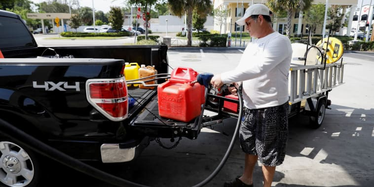 Dax Valenti fills up gas canisters at a gas station in Tampa, Fla., on May 12, 2021.