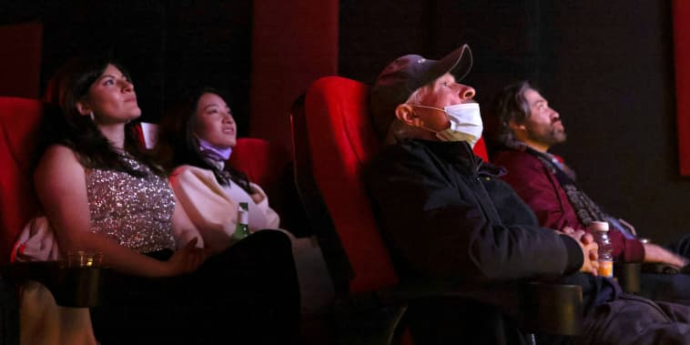 Movie fans wait for an award to be announced during an Oscars watch party at the Stuart Cinema Cafe, in Brooklyn, N.Y., on April 25, 2021.