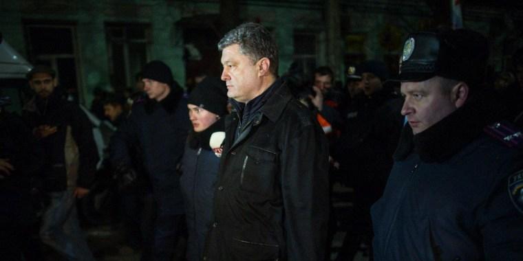 Ukrainian MP Petro Poroshenko is accompanied by police as he is trailed by pro-Russian demonstrators in the Crimean city of Simferopol on Feb. 28, 2014.