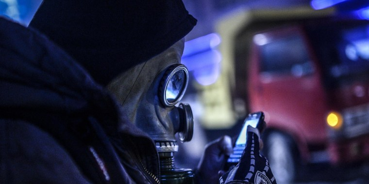 Image: A protester looking at his cellphone screen in Istanbul