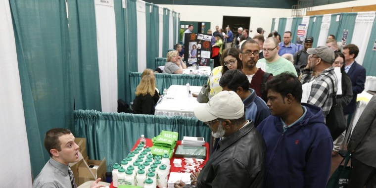 The number of Americans filing new claims for unemployment benefits fell more than expected last week, indicating the labor market was strengthening despite a run-up in applications in prior weeks.