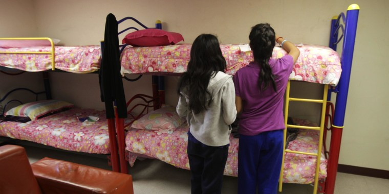 Girls stand in a dorm at the shelter for underage immigrants and repatriated minors in Ciudad Juarez. Mexico, on May 27, 2014.
