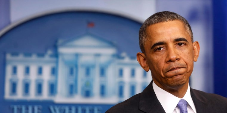 Image: U.S. President Obama pauses while talking about the Affordable Care Act at the White House in Washington